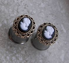 "Cameo Plugs - Available in sizes 2g, 0g, 00g, & 7/16"". $20.00, via Etsy."