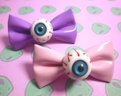 Creepy-Cute Eyeball Bow Hair Clip by LotsesofFoxes on Etsy