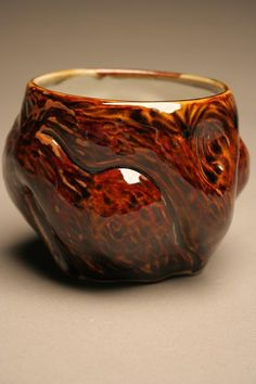 Brown Undulating Cup at $20.00.    This tenmoku glazed cup was thrown on the wheel, altered and carved to fit the hand and the eye. Enjoy a warm beverage or a spot of soup and place the cup in the dishwasher for clean up.