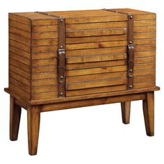 Three-drawer chest with brown straps and nailhead accents.Product: ChestConstruction Material: Wood  ...