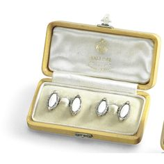 A PAIR OF FABERGÉ JEWELLED AND ENAMELLED GOLD CUFFLINKS, WORKMASTER AUGUST HOLLMING, ST PETERSBURG, 1899-1908 the links formed of ellipses of pearl white enamel over sunburst engine-turning within rose-cut diamond borders, the ends set with larger diamonds, in Fabergé fitted case, struck with workmaster's initials, 56 standard Quantity: 2 length of links: 1.7cm, 3/4 in Estimate 15,000 — 20,000 GBP  LOT SOLD. 28,800 GBP