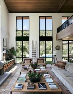 Wonderful colour contrasts from dark window frames, mid toned wood ceiling to pale walls and neutral upholstery. A beautiful balance of neutral colour.