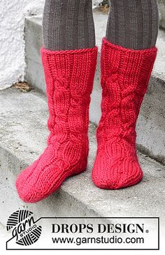 Knitted socks with cables for Christmas in DROPS Eskimo.