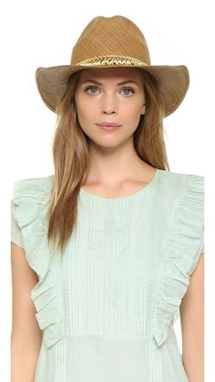 A woven Sara Designs fedora. The thread-wrapped curb-chain band has beaded fringe trim and closes with a toggle clasp.