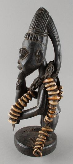 Wears necklace of strings of cowrie shells threaded on leather thongs. Voodoo, Afrique Art, African Sculptures, Art Premier, Yoruba, African Diaspora, African Masks, Tribal Art, Black Art