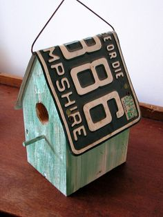 I like how they use a license plate for the roof of the bird house
