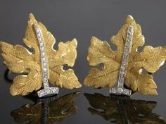 2 Tone 18 Karat White And Yellow Gold Leaf Motiff Earrings Consisting Of Approximately .50 Carats Of Full Cut Diamonds The Earrings Are Signed Buccellati.