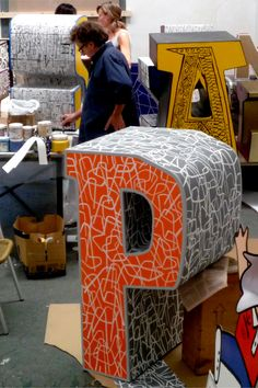 mariscal make chairs with big letters