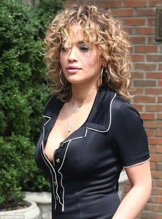 Pouty: Rita looked like a true bombshell as she pulled a series of sultry faces while strolling down the sidewalk