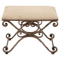 Showcasing a scrolling iron frame and linen seat, this elegant stool is perfect pulled up to your vanity or as extra seating in the den.   ...
