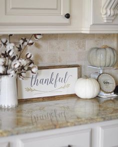 Thankful sign. White pumpkin. Kitchen counter
