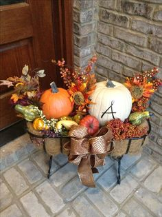 Fall porch pumpkin basket :)