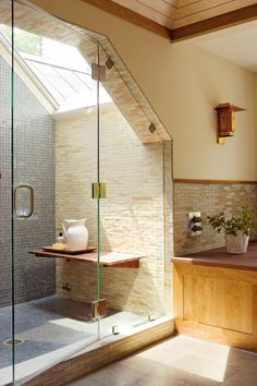 Walk-in showers are a practical, attractive choice for bathrooms large and small. Create a gorgeous walk-in shower with our tips on tile treatments, lighting, layout, storage, and more. #walkinshower #walkinshowerideas #bathroommakeover #showerideas #bhg Shower Seat, Walk In Shower, Shower Rod, Douche Design, Craftsman Bathroom, Slanted Ceiling, Large Shower, Glass Shower Doors, Shower Enclosure