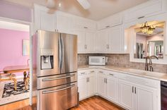 Traditional Kitchen With Food Showcase French Door Refrigerator In Stainless Steel Tuscany Walnut Tumbled Tile