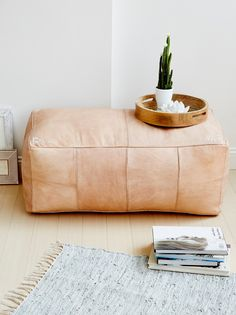 Large Rectangle Pouf | Add an extra level of decorative and comfy ambiance to any room with his beautiful large leather pouf featuring tribal-inspired hand embroidered corners. This accent piece is handmade from natural colored leather in Morocco and has been stuffed was poly-fiber fill in Philadelphia.