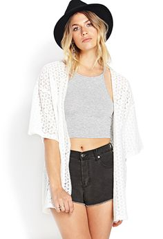 A longline woven cardigan featuring an ornate pattern. Open-front. Oversized 3/4 sleeves. Finished trim.  http://foxyblu.com/details/139121