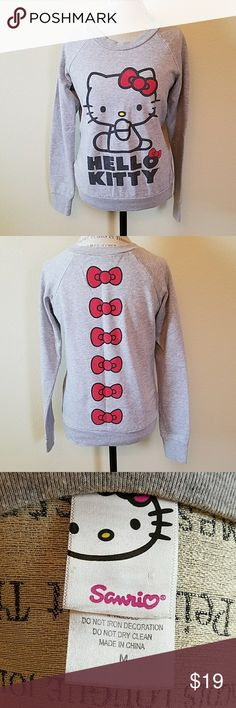 🆕Sanrio Hello Kitty Sweater Shipping cost seem to high for one low-priced item? --> Bundle & SAVE! All of my items are ready to ship.  ++++++++++  GUC  ❗Moving to the tropics, no more sweaters for me❗  #CUTE timeless sweater  Colors = Red, Black, Grey, Yellow (nose!)   60% Cotton / 40% Polyester Sanrio Sweaters