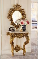 Sculpted roses spring forth from this replica 17th century antique destined to become a striking centerpiece of your home. Designed to anchor safely to a wall, the stately, almost yard-tall console is topped with a beautiful, quality faux marble top. The generously sized, companion salon mirror sparkles to reflect its own ornate, beribboned sculpt. Beautifully paired in a stylish entryway, both grand scale pieces are cast in quality designer resin and finished in faux antique gold as an investment in European style.