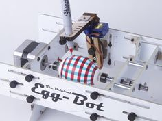 """Do you love dying Easter Eggs? Check out the by Evil Mad Scientist Labs! t's an """"open source art robot"""" that can draw on spherical or ellipsoidal. Evil Mad Scientist, Incredible Eggs, Open Source Hardware, Whatsapp Tricks, Prusa I3, Easter Egg Designs, Easter Ideas, Easter Recipes, Maker Culture"""