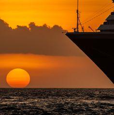 Sunset over Curacao. Let Uniglobe Travel Designers help plan your dream cruise! www.uniglobetraveldesigners.com