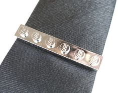 Chrome Silver Tie Slide, these are 1 x 6 LEGO® Plates that have been chromed and attached to silver tone tie slides to make a cool and unusual tie