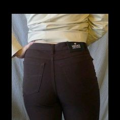Versace dark brown high waisted pants Super hot authentic Versace pants! Very dark brown with gold buttons. Straight leg fit with Built in stretch for curve fitting at its best! Please feel free to ask for more photos or measurements if you are interested #versace #sexy #designerclothes Versace Pants Straight Leg