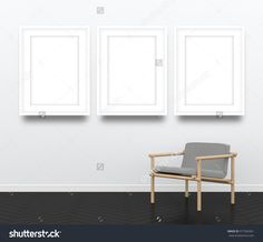 3d interior rendering of three blank picture frames and gray wooden armchair