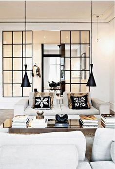 Beautiful Living Rooms | Glass panels leave the space open but give separation, light fixture and accessories compliment glass panel design.