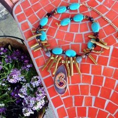 Handmade boho summer statement necklace  This stunning piece was inspired by my new colorful and flower-full padio!  Sitting outside and creating with my kitty, this piece just emerged.  A completely unique mixture of wood beads, magnesite, garnet, crystal, and more!  A beautiful agate slice pendant with stunning detail! gabriella designs  Jewelry Necklaces