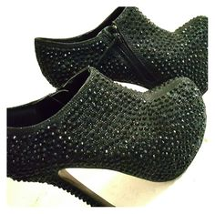Chic Black crystal booties 6 inch heel. Completely covered in all black crystals. Worn total or three times over 4 years I had a hard time walking in them. I loved these they are georgous and it pains me to be selling them but I have no use for them any more. Size 7 true to size I wouldn't say they are long wearing shoes but defiantly a good statement piece. Shoes Ankle Boots & Booties