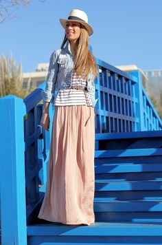 Light denim jacket, pink maxi skirt, nautical stripes t-shirt, and white hat