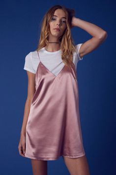Say it's only a paper moon Gorgeous, soft and silky lingerie inspired slip dress. Wear it as is with heels or ballet flats and a choker for a sweet date night look. Or add a cute baby tee and Dr. Mart