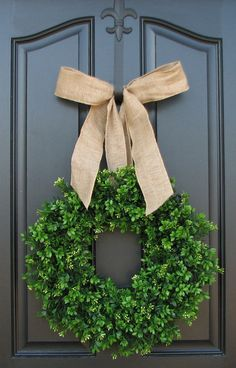 Holiday Outdoor Decorations - I love the burlap ribbon used to hang this wreath!