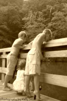 "I wish I could enjoy a moment like this. "" Taking a picture of your three kids fishing."""