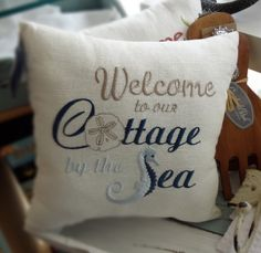 'Welcome to our cottage by the sea' pillow sold at Mermaids.