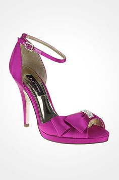 It doesn't get much more glamorous than these vibrant pink Nina heels with a crystal embellishment and thin ankle strap.