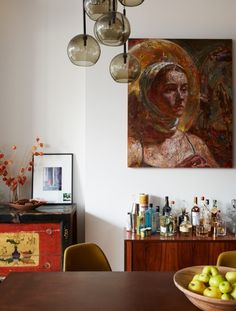 """The painting above the """"cocktail cabinet"""" is by Chinese-American artist Victor Wang."""