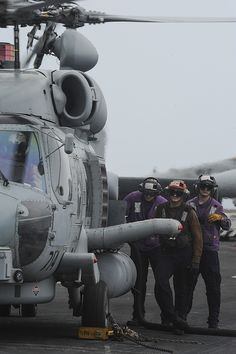 GULF OF OMAN (June 13, 2013) – Sailors stand by while refueling an MH-60R Sea Hawk helicopter assigned to the Wolf Pack of Helicopter Maritime Strike Squadron (HSM) 75 on the flight deck of the aircraft carrier USS Nimitz (CVN 68). Nimitz Strike Group is deployed to the U.S. 5th Fleet area of responsibility conducting maritime security operations and theater security cooperation efforts. (U.S. Navy photo by Mass Communication Specialist 2nd Class Devin Wray/Released)