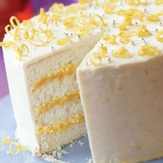 This light and tender cake flavored with lemon, layered with tangy lemon curd, and coated with a voluptuous lemony butter frosting will make any birthday happy. But why wait until then?