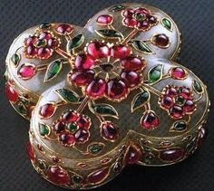 Mughal gem set box in nephrite jade, rubies and emeralds.