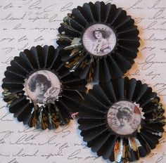 Love this idea! Use up all that gaudy old wallpaper, and use it to make photo frames! You can find a tutorial for paper rosettes on my 'How to Make: Paper Edition' board.