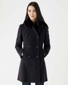 Timeless double-breasted military-style coat with detachable faux fur collar in soft wool-blend.  Single back vent, sartorial back structure and visible stitch pockets. Add to your wardrobe for the perfect winter cover-up.