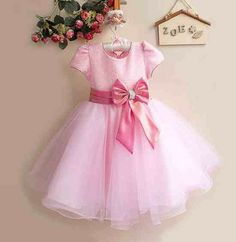 Stunning pale pink ball gown style dress, beautifully decorated with sparkles to the top half. Flowing length with glitter and a bow to front, with detachable bow to rear – http://www.mypreciousgifts.co.uk/products/pale-pink-sparkle-dress
