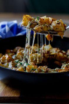 Roasted cheesy breakfast potatoes - Simply Delicious. #brunch #breakfast #cheese #potatoes #vegetarian #vegetarianfood #GlutenFree #glutenfreerecipe