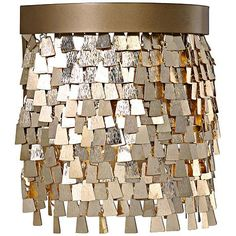 This matte gold and textured gold one-light wall sconce is a bright, fun look that will complement most any home decor style.