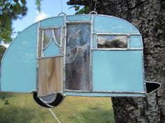 This suncatcher is handmade, each piece has been cut, foiled and soldered . It is approximately 4.5 x 7.5 inches and is an aqua color with