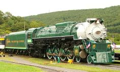 """C & O RR 4-8-4 locomotive #614. This engine was traded to Ross Rowland after his ex-Reading engine was damaged in a roundhouse fire and it went on to have a long history as a durable excursion engine. Painted in the Greenbriar """"Presidential Express"""" colors, it may be resurrected as an excursion engine again."""