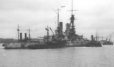 15 in German battleship Baden arriving at Portsmouth under tow in 1921.  After being interned at Scapa Flow she was scuttled in 1919 with much of the High Seas Fleet but subsequently raised: later in 1921 she was expended as a target.  Baden and her sister Bayern were completed too late to fight at Jutland.