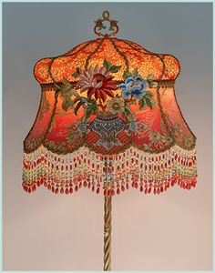 Exceptional heavy ornately stylized antique floor lamp with a twirling center pole has been hand painted and holds a hand-dyed Gold and Red Chinoiserie Vase silk lampshade. Silk applique of flowers in