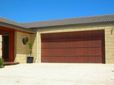 Our Ultimate Sectional Garage Doors are all about flaunting absolute street appeal. Create a custom design to suit your taste and budget. Centurion's Ultimate Range doors are each distinctive in their own right. Timber Garage Door, Custom Garage Doors, Garage Door Design, Custom Garages, Sectional Garage Doors, Laser Cut Panels, Decorating With Pictures, Types Of Wood, Custom Design